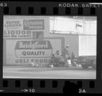 "Men of ""bottle gang"" gathered outside liquor store in Los Angeles, Calif., 1977"