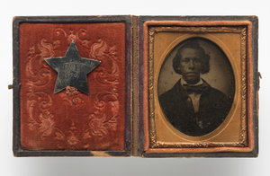 Tintype of Creed Miller with star-shaped military identification pin