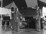 Black Agenda Business Fair participant Gil Lindsay speaking to an audience, Los Angeles, 1983