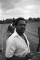Man holding a trowel while standing in an agricultural field at Tuskegee Institute in Tuskegee, Alabama.