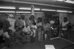 Black Track, Inc. food give-a-way participants posing for a group portrait, Los Angeles, 1990