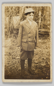 Photographic postcard of a boy wearing a double-breasted jacket and breeches