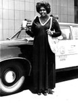 Woman in front of police car