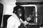 Radio broadcaster performing in a mobile studio, Los Angeles, 1980