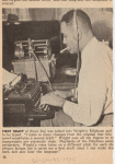"""Author Richard Wright sitting at typewriter and listening through an Ediphone to create a draft of his autobiography """"Black Boy."""""""