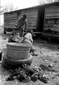 Three children of John Nixon playing on a metal barrel in their yard in Autaugaville, Alabama.