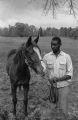 Man tending Frank Hampton's racehorse