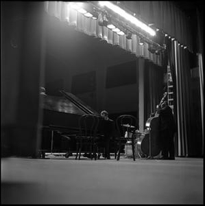 [Dave Brubeck Quartet performing, seen from off left]