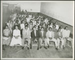 Assembly of African American students in auditorium