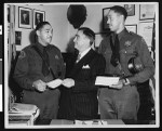 Los Angeles County Sheriff Eugene Biscailuz and two deputies at graduation ceremonies, Los Angeles, 1950
