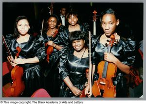 Photograph of orchestra students holding their instruments Christmas/Kwanzaa Concert Hallelujah Hip Hop Concert, December 1995