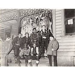 Members of the Nimrod Hunting Club with strung up deer