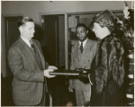 Schomburg Collection Mrs. Roosevelt presenting the President's manuscript copy of the radio address on the Atlantic Charter: Mr. Francis R. St. John, Chief of Circulation Department, New York Public Library; Dr. Lawrence D. Reddick, Curator of the Schomburg Collection of Negro Literature; Mrs. Franklin D. Roosevelt