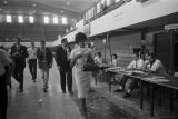 Vivian Malone registering for classes in the gym of Foster Auditorium at the University of Alabama.