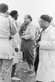 Actor Gary Merrill talking to several men, possibly reporters, during the Selma to Montgomery March.