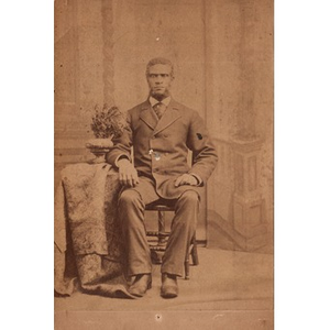 A bearded African-American man sitting for a portrait.