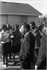 Martin Luther King, Jr., and others arriving for a meeting at a small rural church building in Greenville, Alabama.