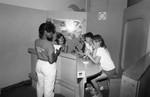 Children's Museum visitors participating in an exhibit, Los Angeles, 1986