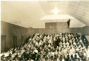 Photograph of patients and staff members watching a moving in the Playhouse at the Georgia Warm Springs Foundation, Warm Springs, Meriwether County, Georgia, 1930-1940?
