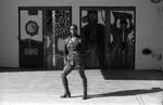 Raiva posing in front of Arena doors