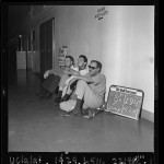 Three CORE hunger strikers sitting in hallway at Los Angeles Board of Education Building, 1963