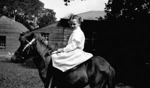 Unidentified girl on horse.