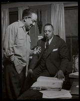 Four photographs of Langston Hughes, one including an unidentified man