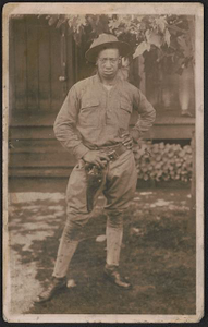 [Unidentified African American soldier in uniform and campaign hat with handgun in holster
