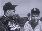 Roy Campanella, former catcher for the Dodgers, returns to baseball to help Manager Walt Alston coach the catchers