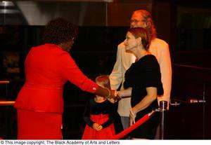 [Women shaking hands] Hip Hop Broadway: The Musical