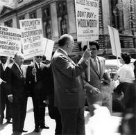 Members of the ILGWU Local 105 picket against Woolworth's segregation and discrimination policies, 1963. In sunglasses is Eddy Walinus, and on his left, Morris Bagno