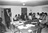Man addressing an audience at the office of the Autauga County Improvement Association in Prattville, Alabama.