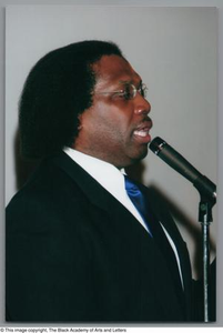 Curtis King addressing guests at Christmas Kwanzaa soiree Christmas/Kwanzaa Soiree