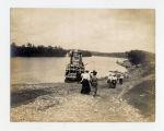 Women walking down the riverbank