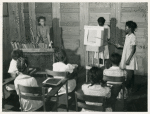 4th and 5th in Flint River school, Ga. demonstrate a health moving picture, which they made. May 1939