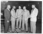 Lay leaders from Baltimore YMCA meet Executive Secretary, Mr. Lawrence Hunt, at the Twelfth Street Branch YMCA, Washington, D.C.. From left to right: Mr. William Carter, member of the Boys' Work Committee at the Druid Hill Avenue Branch YMCA; Mr. Alp...