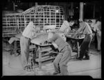 Manpower. Negro bomber plant workers. American manpower teaming up to beat the Axis. Negro and white employees of a large Eastern aircraft factory work together in attaching skins to the fins of medium bombers. Glenn L. Martin Bomber Plant. Baltimore, Maryland