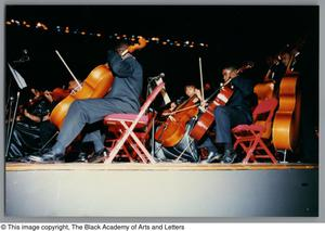 Photograph of cellists playing their instruments Christmas/Kwanzaa Concert Hallelujah Hip Hop Concert, December 1995
