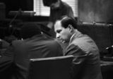Anthony Ray Hinton conferring with his lawyer, Sheldon Perhacs, during his capital murder trial in Birmingham, Alabama.