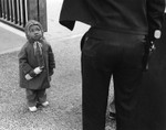 African American child and policeman
