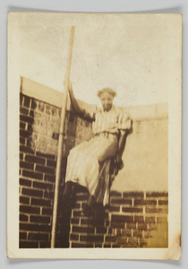 Photographic print of a woman on a brick wall