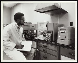 Chemist using Perkin-Elmer instruments at Detroit Edison Company laboratory