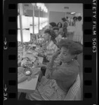Kimolin Smith and other contestants applying their make-up before the Miss Inglewood Pageant, Calif., 1984