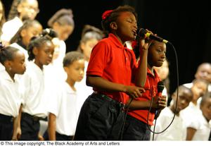 Choir singer stands on stage while singing