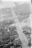 Thumbnail for Aerial: Riots: Detroit: Race Riot. An aerial view of Grand River as buildings are consumed by fires.