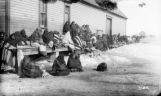Sioux squaws waiting for rations at commisary [sic] P.R. Agency S.D. Sioux squaws waiting for rations