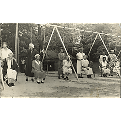 Elderly women on swings in Highland Park