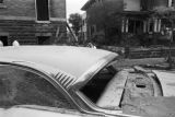 Damaged cars in the street outside of 16th Street Baptist Church in Birmingham, Alabama, after the building was bombed.
