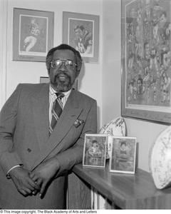 Abner Haynes posing with football memorabilia Dallas/Fort Worth Black Living Legends Dallas/Fort Worth Black Living Legends, 1991