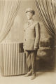 Unidentified African American man in a policeman's uniform.